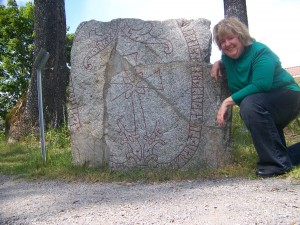 Kelly makes friends with a Swedish runestone