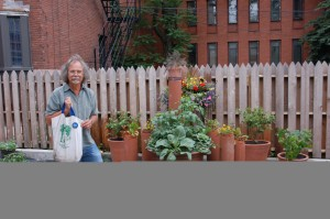 CKP Director Bart Schultz stands by the 5710 garden, with new containers generously donated by Smith & Hawken.