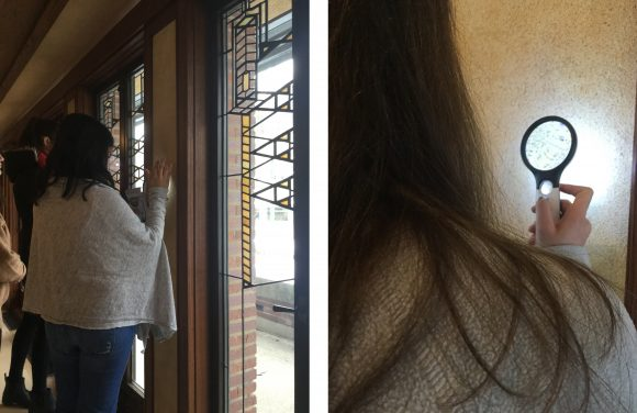 left: A conservation student faces a stained glass window in the Robie House holding a magnifying glass to a white wall. Right: A behind the shoulder photograph of a student holding a lighted magnifying glass to a white wall in the Robie House.